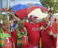 Fan of Russia together with the fans of Portugal. DONETSK, UKRAINE - JUNE 27, 2012: Fan of Russia together with the fans of Portugal in Donetsk before the semi Stock Images