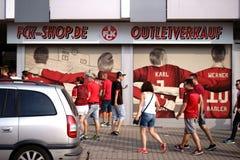 Fan-Shop 1. FC Kaiserslautern. Kaiserslautern, Germany - August 07, 2018: Fans of the 1. FC Kaiserslautern football club in front of a fan shop on August 07 stock photos