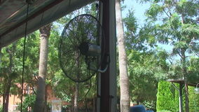The fan is spinning in the outdoor pavilion stock video