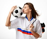 Fan sport woman player in russian uniform hold soccer ball celebrating kissing Stock Photography