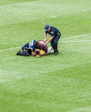 Fan tackled to the ground. Manchester United fan arrested after running out on the field of Sports Authority Field at Mile High game of Manchester United vs AS Royalty Free Stock Image
