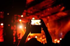 Fan taking photo of concert at festival Royalty Free Stock Images