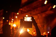 Fan taking photo of concert at festival Royalty Free Stock Photo