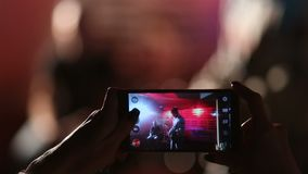 Fan taking photo with smartphone at rehearsal stock video