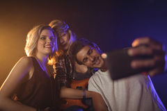 Fan taking picture with female performers. In nightclub Stock Photos