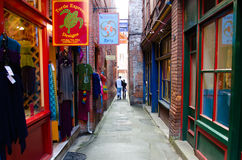 Fan Tan Alley in Victoria, British Columbia. Couple strolls among the shops in historic Fan Tan Alley in Chinatown in Victoria, British Columbia which is only Stock Images