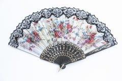 Fan tenue dans la main traditionnelle sur le fond blanc Photos stock