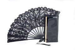 Fan and theatrical handbag. Black lacy fan and the theatrical varnished handbag, the beautician royalty free stock images