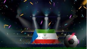 Fan trzymają flagę gwinea równikowa wśród sylwetki tłum widownia w stadium piłkarski z confetti świętować futbol obraz stock