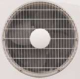 Fan uder white grate. Fan uder white plastic grate on metal plate Stock Photo