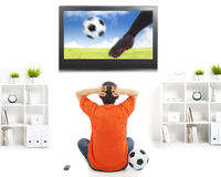 Fan watching soccer game and feeling nervous Royalty Free Stock Photo