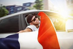 Fan waving French flag out of a car window Stock Photography