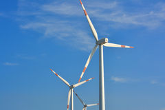 Fan of windmill generator. Fan of windmill power generator, under blue sky, shown as energy industry concept Stock Images