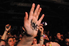 A fan with the word Love on her hand at Razzmatazz Royalty Free Stock Photography