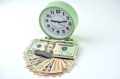 Fan y reloj del efectivo del dinero Imagen de archivo libre de regalías
