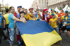 Fan Zone  EURO 2012. KIEV, UKRAINE – 11 JUNE: Football fans from Ukraine and Swedens are    in Fan-Zone of  EURO 2012. Keeps flag of the Ukraine,  June, 11 Royalty Free Stock Photo
