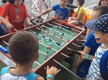 Children play table football on Fan Fest FIFA 2018. Sparrow Hills, Moscow royalty free stock image