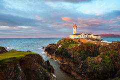 Fanad head at Donegal, Ireland with lighthouse at sunset royalty free stock photo