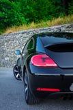 Fanali posteriori e diruttore sinistri posteriori dell'automobile sportiva del coupé Immagine Stock