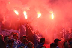 Fanatic fans. WARSAW, POLAND - MAY 02, 2015: Lech Poznan ultra supporters burn flares during Polish Cup Final football match between Legia Warsaw and Lech Poznan Stock Photography