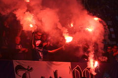 Fanatic fans. WARSAW, POLAND - MAY 02, 2015: Lech Poznan ultra supporters burn flares during Polish Cup Final football match between Legia Warsaw and Lech Poznan Royalty Free Stock Photos