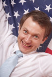 Fanatic man with american flag. Happy fanatic businessman with a american flag Stock Photo