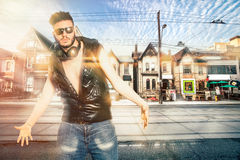 Fanatic young man in the city. Bully boy street and sound style Stock Image