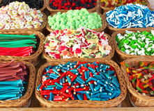 Fanciful candies in baskets. Candies in funny shapes and colors stock photos