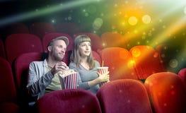 Couple watching something miraculous. Fanciful couple watching miraculous part of a movie Stock Images