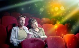 Couple watching something miraculous. Fanciful couple watching miraculous part of a movie Stock Image
