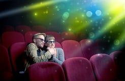 Couple watching something miraculous. Fanciful couple watching miraculous part of a movie Royalty Free Stock Image