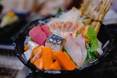 Fanciful serving dish of Mixed Sashimi on ice royalty free stock photography