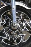 Fancy alloy motorcycle wheel. A fancy black alloy motorcycle wheel royalty free stock photo