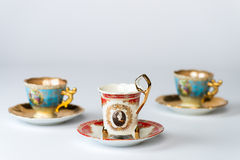 Fancy antique tea cup sets. Three fancy antique sets of tea cups and saucers stock images