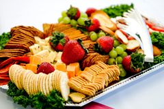 Fancy appetizer platter. A full appetizer tray with crackers, cheese and berries, grapes and pepperoni Royalty Free Stock Photography