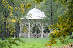 Fancy arbor. Beautiful arbor in autumn park surrounded by green grass stock images