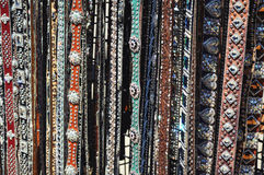 Fancy Belts. A plethora of fancy belts with all kinds of beads, colors, designs, jewels, and glitz stock images