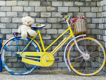Fancy bicycle with cute bear doll Royalty Free Stock Images
