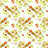 Fancy bird with a sprig of rowan tree. Watercolor seamless pattern with a bird and a branch of berries Royalty Free Stock Photo