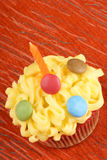 Fancy birthday cupcake with orange candle Stock Image