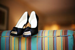 Fancy Blue Heels on a Couch Stock Photography