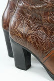 Fancy Boots Closeup. Closeup of tooled leather cowgirl boots Royalty Free Stock Photo