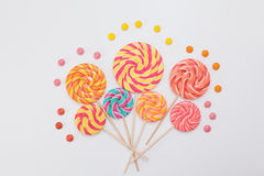 Fancy bouquet of lollipop sweet candy on white. Background. Colorful print of caramel on sticks. Holiday party concept Stock Image