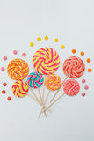 Fancy bouquet of lollipop sweet candy on white background. Colorful print of caramel on sticks. Holiday party concept. Copy space Stock Photos