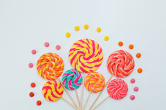 Fancy bouquet of lollipop sweet candy on white background. Colorful print of caramel on sticks. Holiday party concept. Copy space Royalty Free Stock Images
