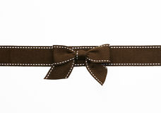 Fancy brown ribbon gift bow. With white stitching on white background Stock Image