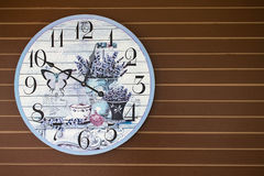 Fancy butterfly and flower clock decorate on wooden wall Stock Photos