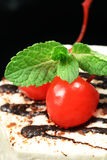 Fancy cake with cherry Stock Image