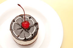 Fancy cake with cherry Royalty Free Stock Images