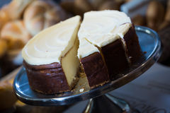 Fancy cake with icing at cafe display Royalty Free Stock Images